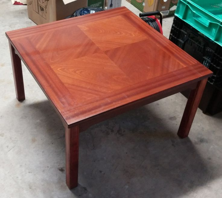 Modern Mahogany Coffee Table. Table top measures 29 inches x 29 inches, 18 inches in height.