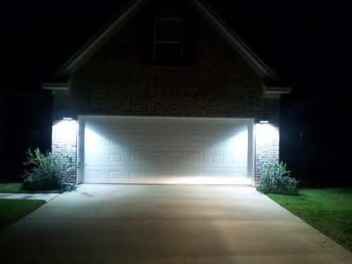 Use LED wall-mount lights for a little extra security and lots of light around the garage.