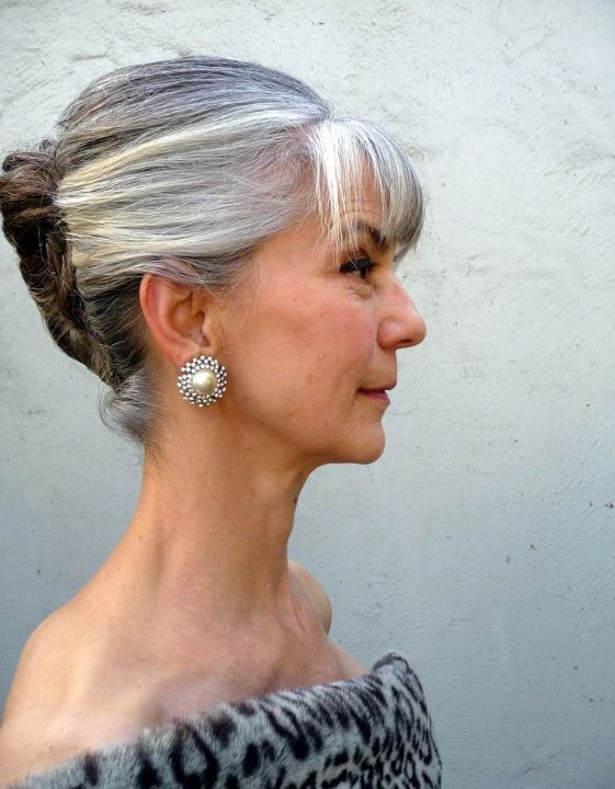 Wow! French twist updo with bangs. Various shades of gray. this is on a facebook page called Going gray, looking great!