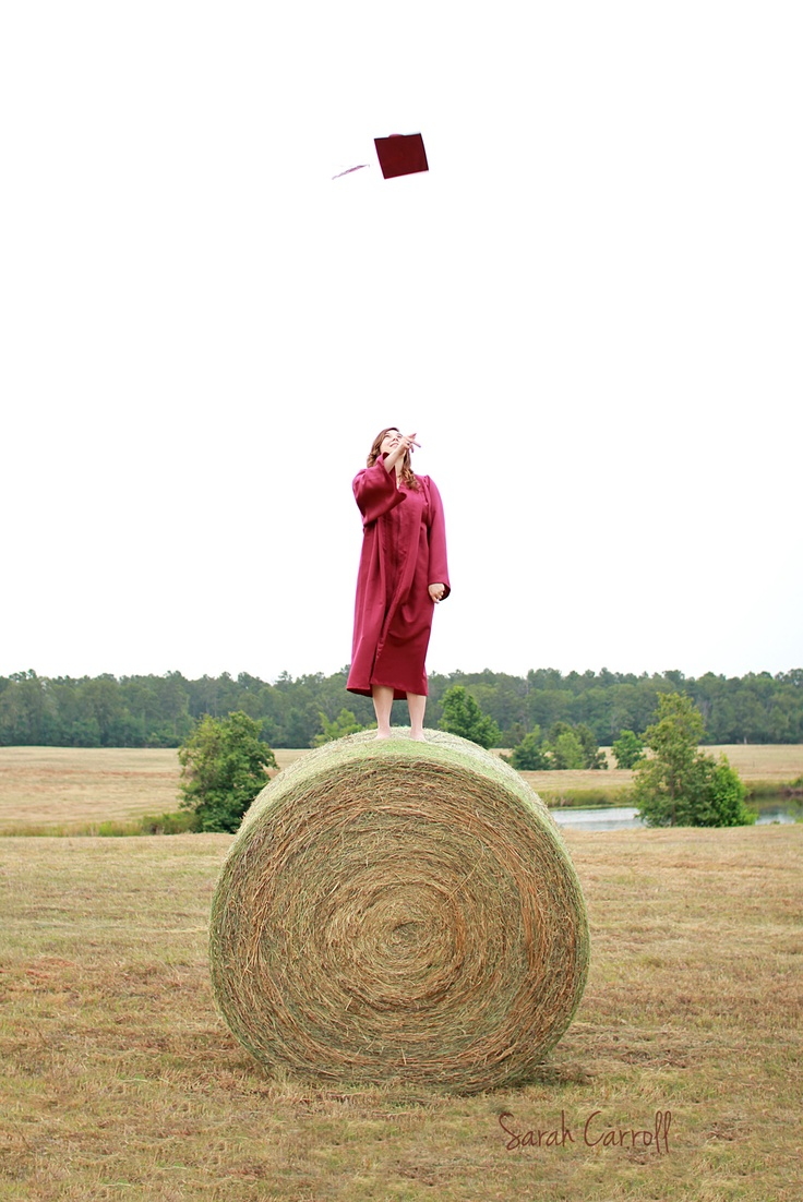 Senior cap and gown picture - throwing cap in the air - hay bale