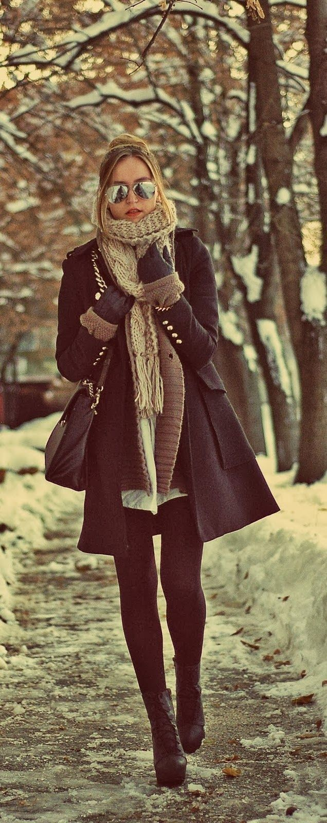 Leather sleeve wool coat paired with leather gloves. Hot!