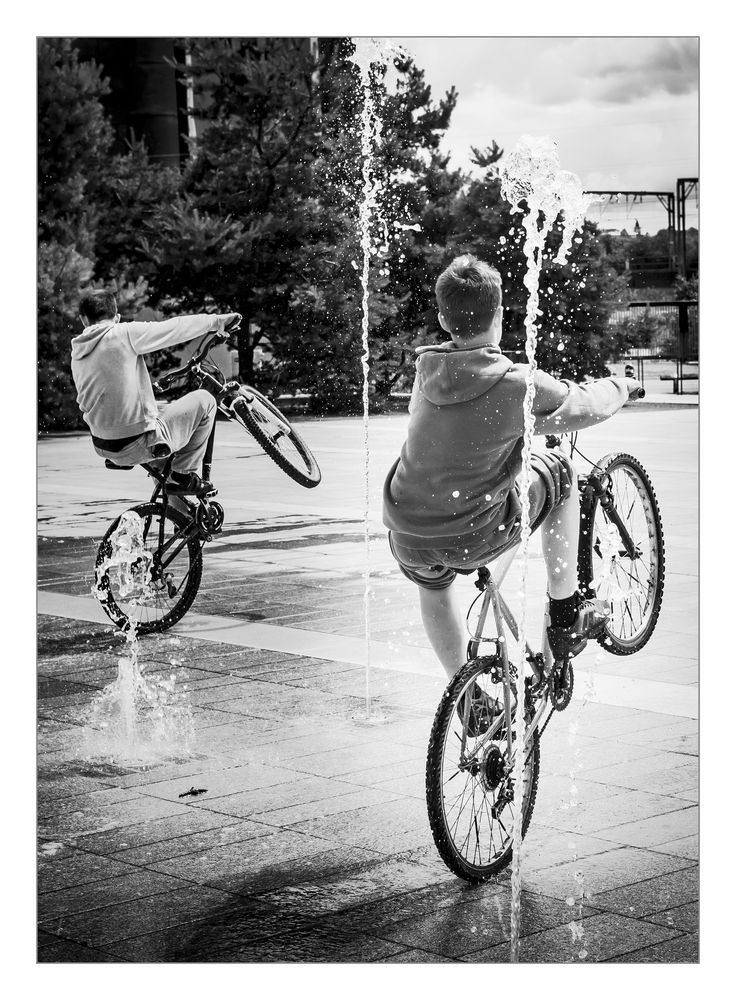 https://flic.kr/p/V9WCpB   BMX Bandits   Fun in the sun. Walking back to the car today I was suddenly 'Buzzed' by a couple of kids on their bikes intent on cooling down in the fountains