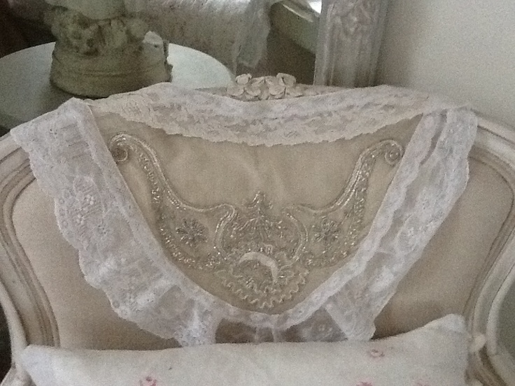 Neckpiece of vintage lace draped over a chair