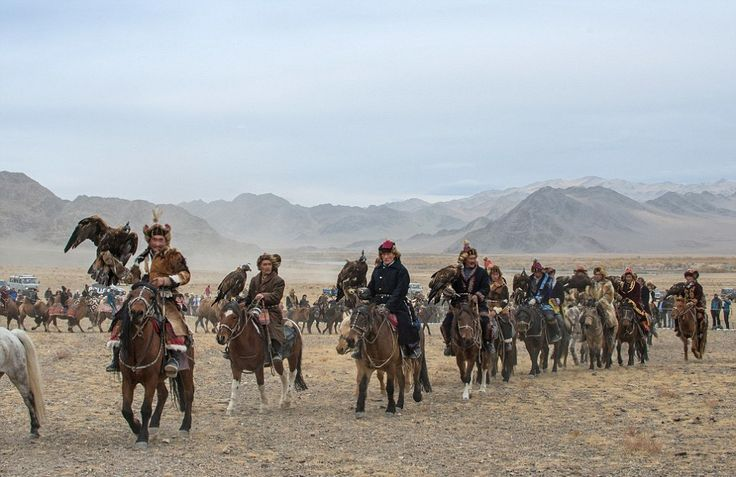 Here, the Kazakh people ride on horseback, accompanied by their trusty eagles.