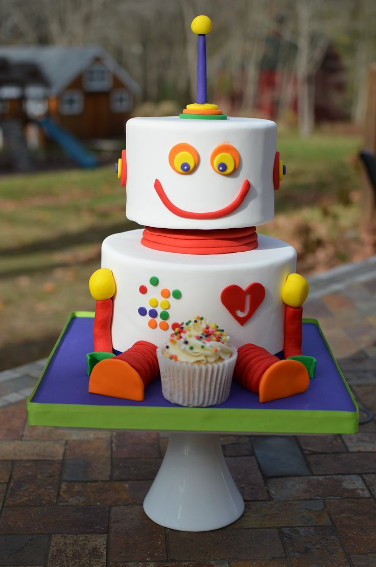A colorful rainbow robot with a confetti cupcake.  This is too freaking cute!