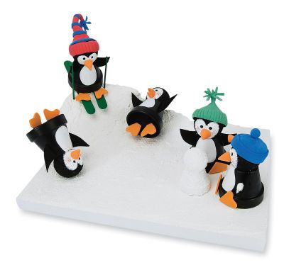 4 penguins out of the smallest claypots, small plastic ornaments (snip off the tops), heart orange foam for feet and beak, felt for hats and black and white paint. One penguin is skiing, another is sledding (popcycle sticks), third one is making a snowman (tiny foam balls), and the last one holding candy.