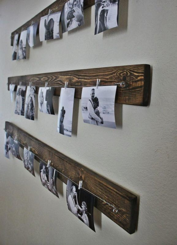 hipster way of displaying your family photo is done easily with wooden planks, clips and couple of wires. Go rustic by hanging your washed-out or black and white pictures on a semi-clothesline. | @giftryapp