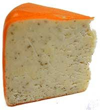 Harlech: a blend of Welsh Cheddar with chopped horseradish and parsley, Harlech has a unique character with a smooth texture that successfully blends the intense flavor of horseradish and the fresh parsley taste. This vegetarian cheese is perfect as a table cheese to add a contrast to any cheese course , paired with a beer or a Rioja.   Cheese Notes