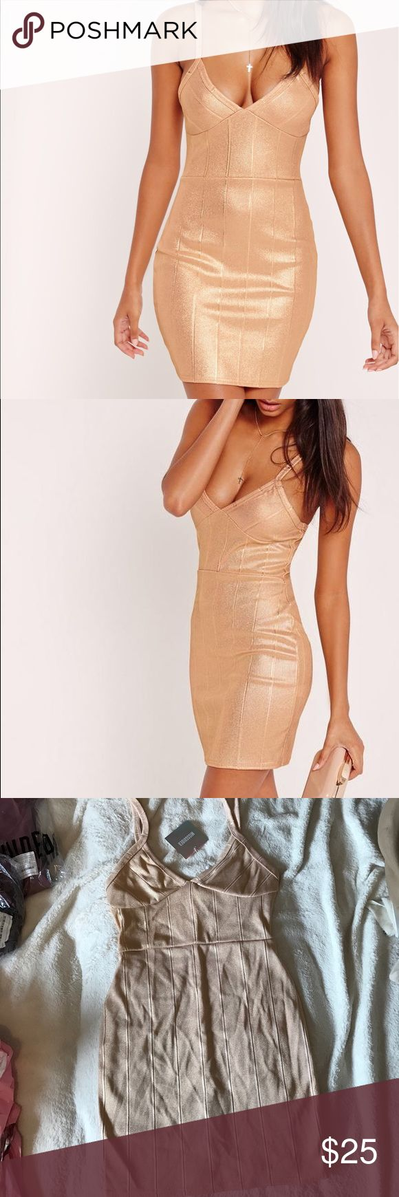 Metallic gold mini dress Amazing metallic gold mini dress! Fits so great to you body! Great for casual day or going out! Size 4 very stretchy! New with tags! Missguided Dresses Mini