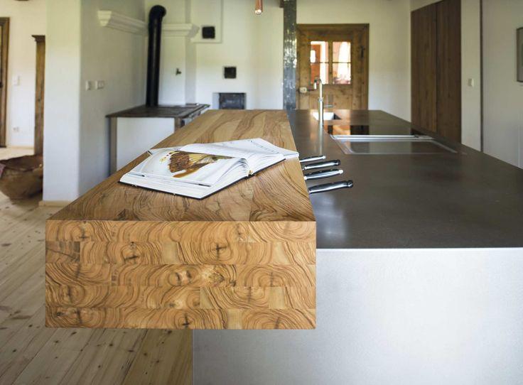 Edelstahl und wurzelholz bei werkhaus küchenideen