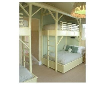 In this soothing bunk room by Pierce Allen, two double beds are placed beneath single beds for an unusual bunk setup.