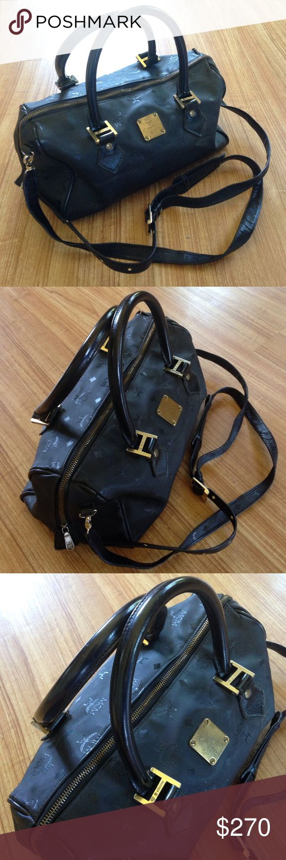 MCM Purse & Crossbody Authentic in good condition no damage the inside needs a light cleaning . A small hole inside the lining,,see pic. No trades Offers are welcomed. MCM Bags Satchels
