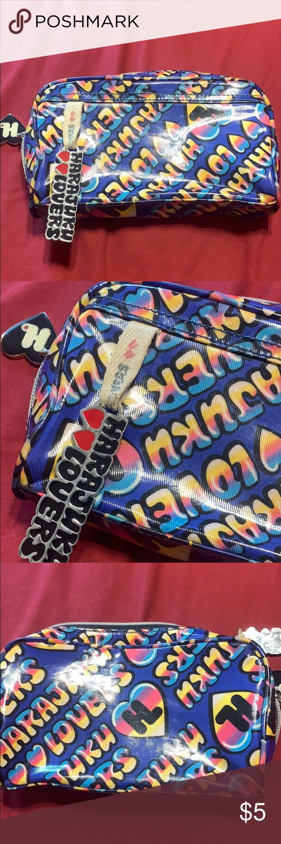 Harajuku lovers makeup bag Pre owned, outerwear is in good condition, inside is …