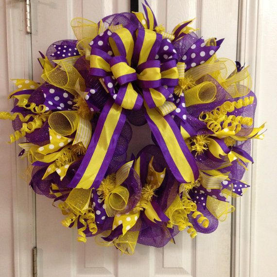 Show your spirit and add this 27 Deco Mesh yellow and purple wreath to your door!! Great for football season