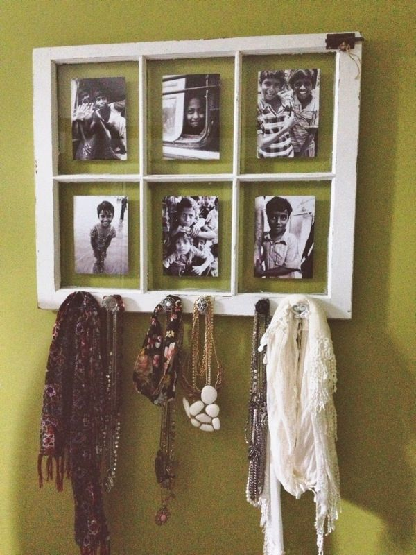 Old window to hang jewelry and scarves with black and white pictures!