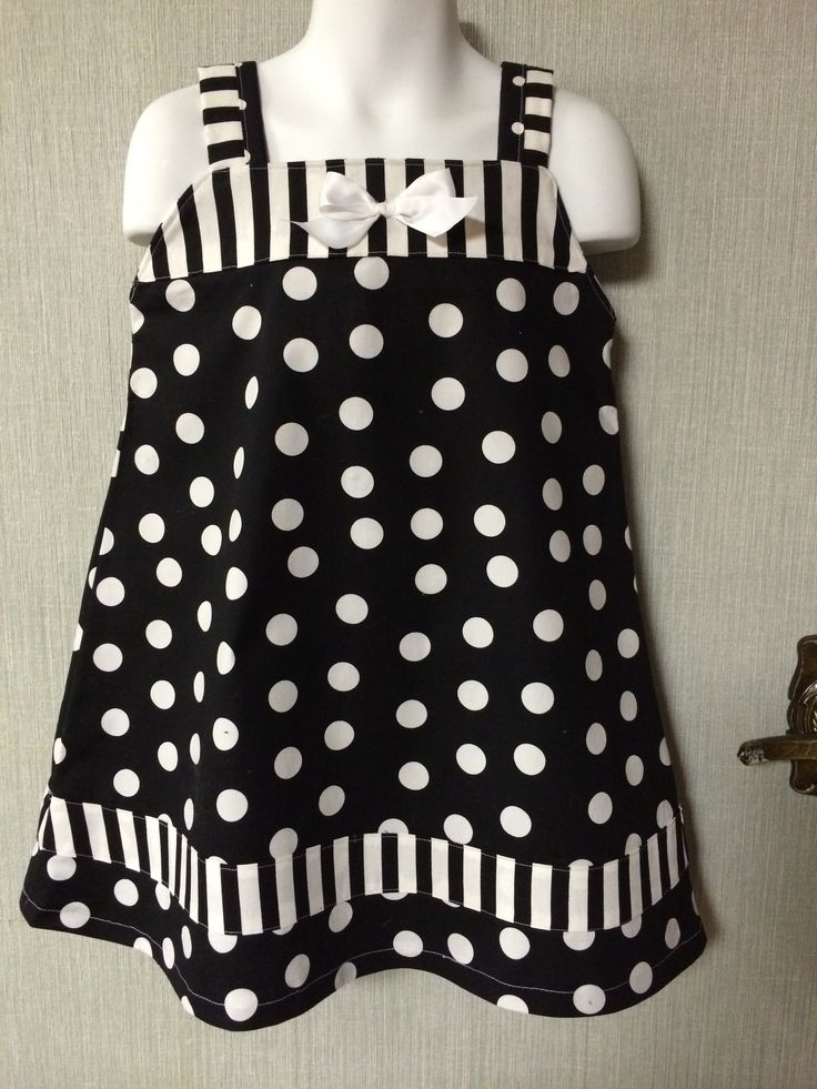 Polka dots and Stripes cotton...Classy, yet comfortable. Can be worn alone or with a long sleeve t-shirt for the colder months. Size 2/3.....$24. Comes with matching headband!!!