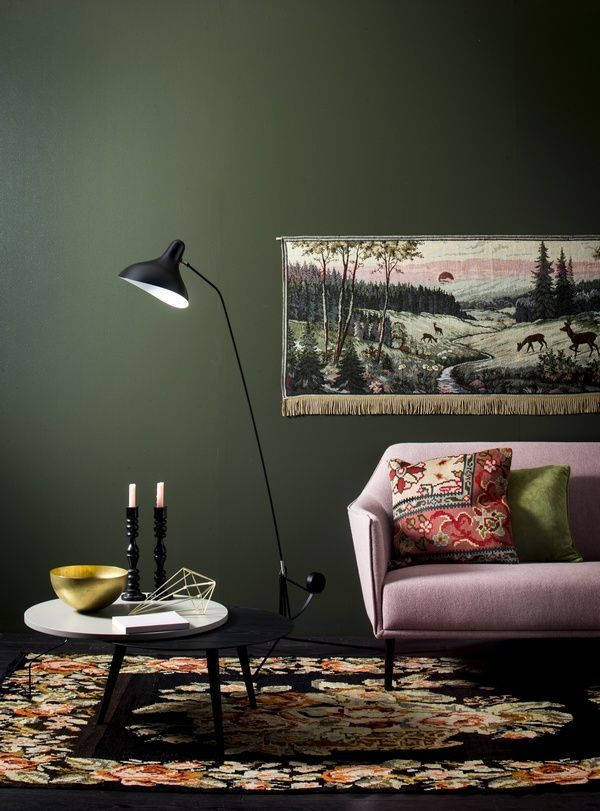 dark green walls, pink sofa