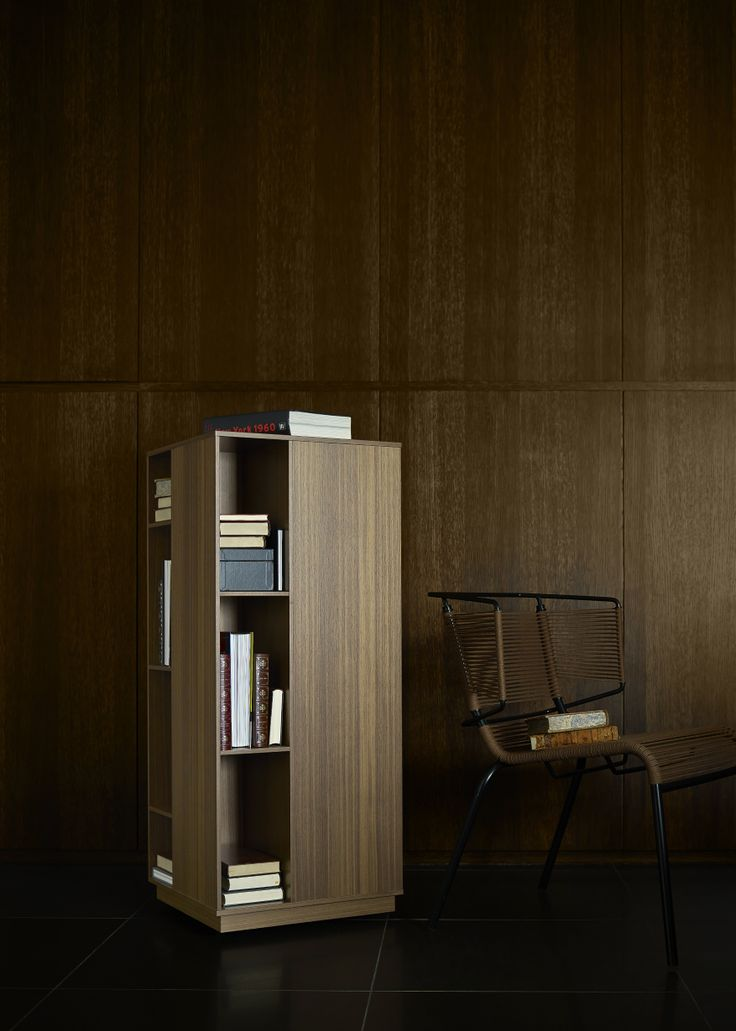 Inspirational Ligne Roset Book and Look Rotating Tower Structure resting on a rotating ball bearing mechanism The MDF supportbase is weighted with a steel disc for