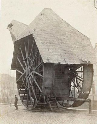 Treadwheel harbour crane built in the London docklands, 1850s, each walked by 3 to 4 men.  Via Low-tech Magazine (http://www.lowtechmagazine.com/2010/03/history-of-human-powered-cranes.html).