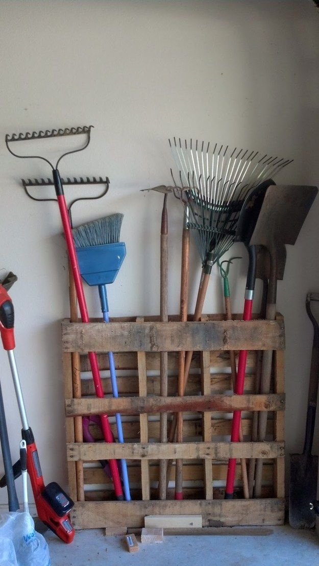 Stand an old wood pallet on its side for instant garage organization. http://garageremodelgenius.com/