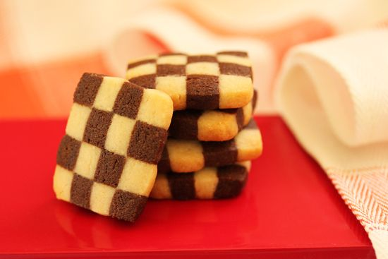If you're looking for a stunning cookie to impress your guests, these Black and White Checkerboard Cookies from Cook & Be Merry are it!  Vanilla and chocolate cookie doughs are layered two times to create the unique checkerboard pattern.