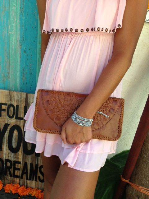 Quality leather clutch in Tan.  Handmade and braided in a mandala design.  Measures 14cm x 29cm.  Available from www.bohemianliving.com.au