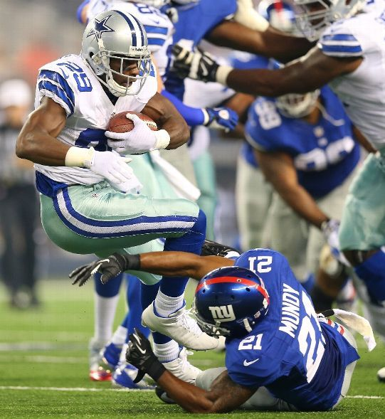 ... Elite Jerseys Bears Knit Performance Shorts Running back DeMarco Murray  29 of the Dallas Cowboys is tackled by ... 82812e082