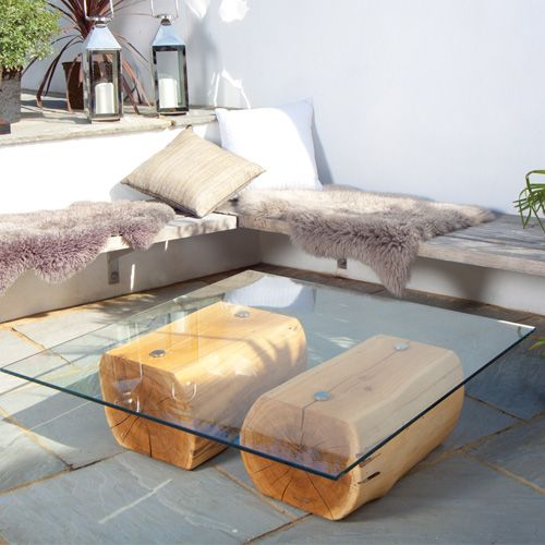 Two really chunky oak trunks skilfully hand-finished and topped with clear toughened glass to create a stunning modern oak coffee table. #Portwoodstudio