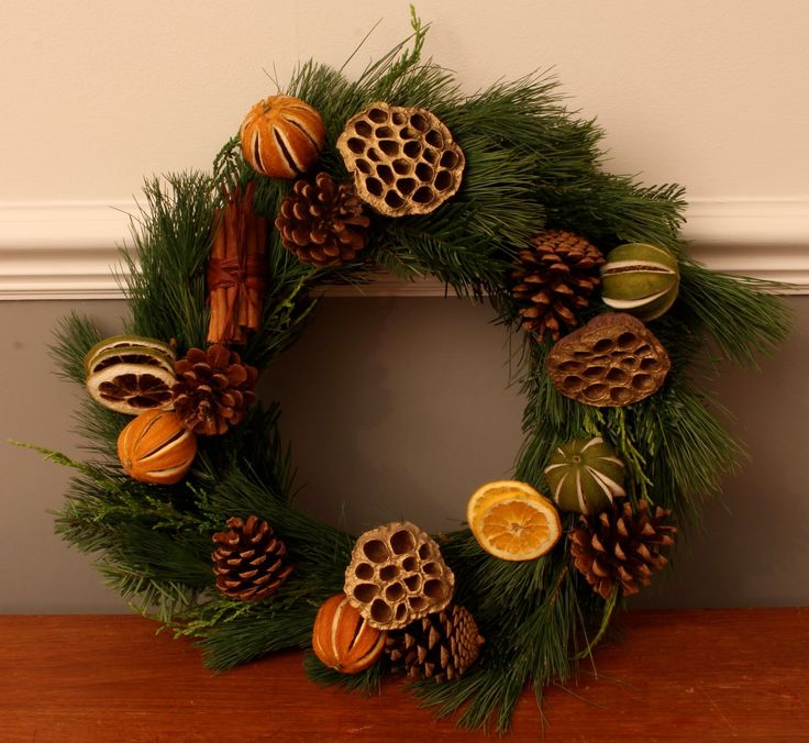 A beautiful Christmas wreath with dried citrus, pine cones and cinnamon