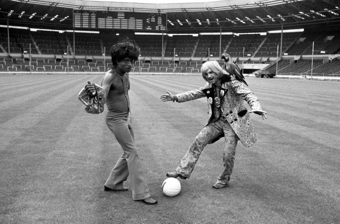 Flamboyant rock 'n' rollers Little Richard and Screaming Lord Sutch (along with his parrot) enjoy a kick-about on the Wembley turf ahead of a charity game, 1972