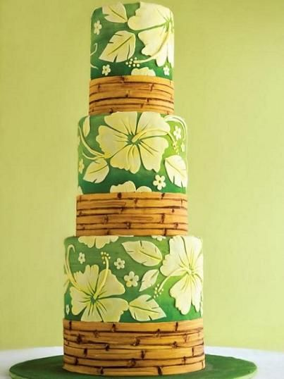 4. Tropical Paradise…  Photo: Fashionablebride.comCake: CakelavaTake your guests on a trip to Hawaii with this tropical beauty. Made with fondant to make things a …