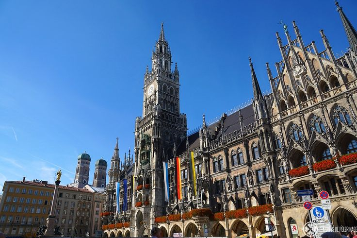 The marienplatz in Munich with its neo-gothic city hall and the Frauenkirche in the background. Start your one day in Munich tour here.