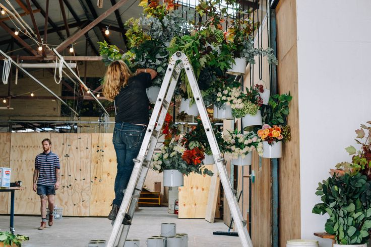Poppy Installing Floral Hanging Feature / Flowers Poppy Lane / Image by Bobby + Tide