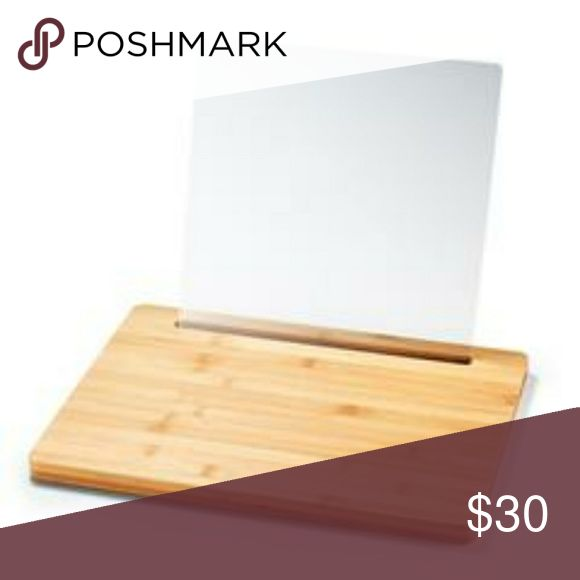 2-In-1 Bamboo Cutting Board W/ Tablet Holder Get tech savvy in the kitchen! A tablet holder with a protective sheath to shield from splatters and spills. Ever wonder why we often see bamboo used in products? This amazing material is not only eco-friendly, easy to maintain and durable...But it is also adorably chic for the kitchen. WOW!  -ACRYLIC bamboo cutting board that has a slit at the top which allows the plastic tablet holder to sit in -Can then rest a tablet on it for easy viewing…