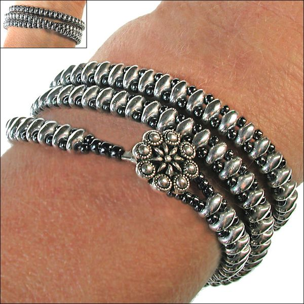 This shiny and smooth bracelet feels so good against your skin. Beautiful in its visual complexity, this seemingly metallic piece...