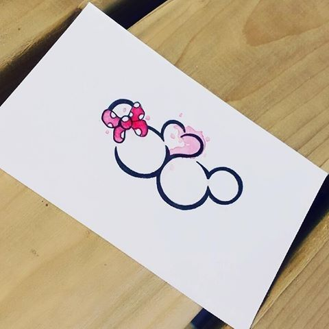 Romantic connected Minnie and Mickey Mouse heads tattoo design