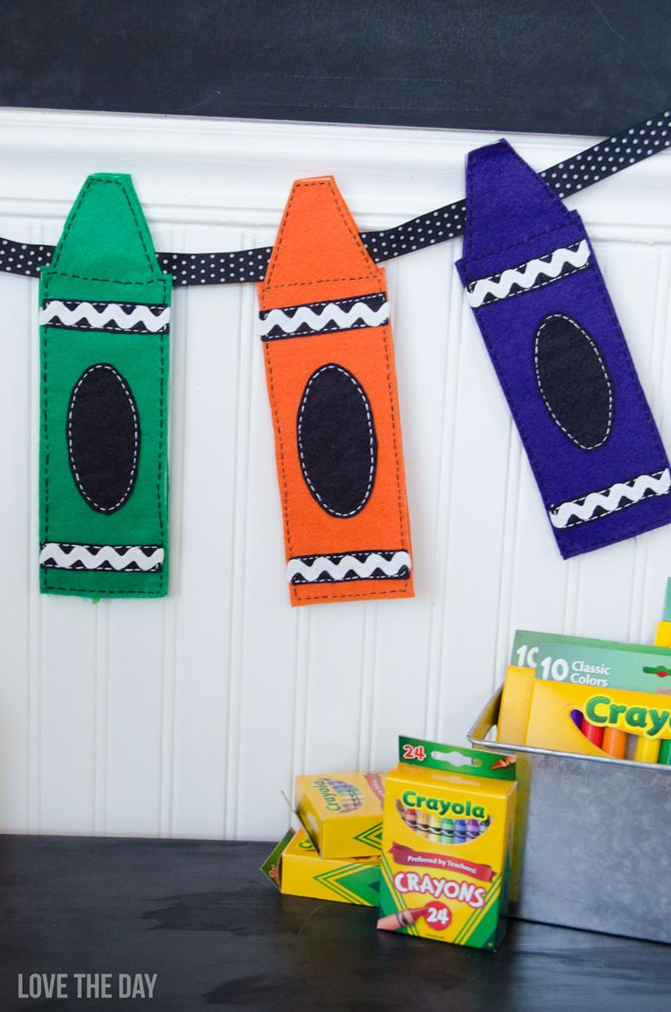 Celebrate back to school with a party decorating with Felt Crayon Garlands and school supplies! A full tutorial and download available.