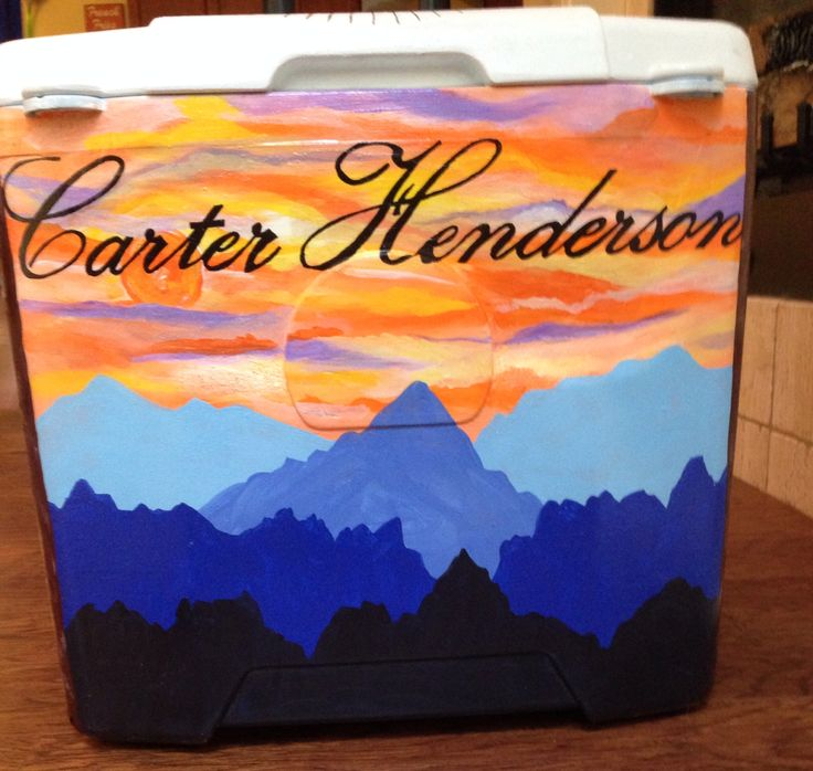 My boyfriend's fraternity cooler with a sunset and mountains. The surface was sanded, primed, then spackled prior to painting. #universityofarkansas #formal #pike