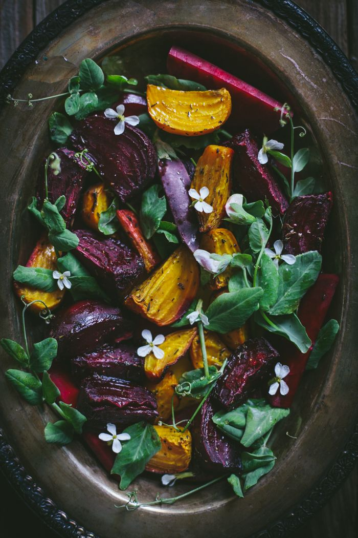 A healthy and delicious roasted beet salad with pea shoots, and chA?vre, aka goat cheese.