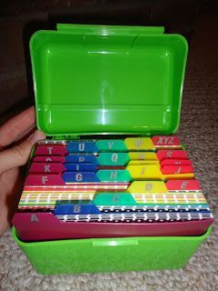 Organize word wall cards in index card holder.  Teacher used colored index cards to back printed word cards.