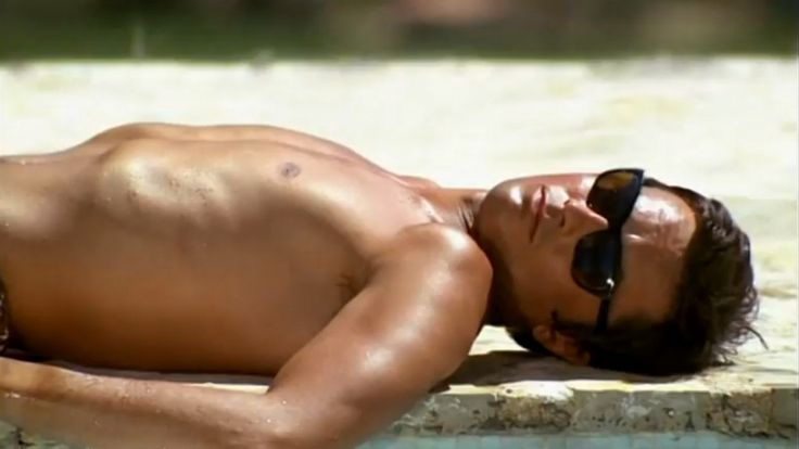 """Alain Delon wearing sunglasses. Still from """"La Piscine""""."""