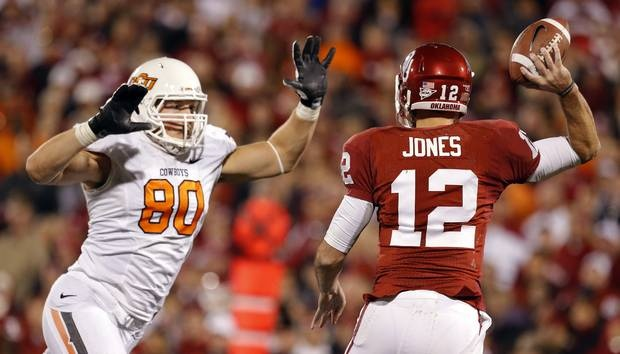 Oklahoma State's Cooper Bassett (80) pressures Oklahoma's Landry Jones (12) during the Bedlam college football game between the University of Oklahoma Sooners (OU) and the Oklahoma State University Cowboys (OSU) at Gaylord Family-Oklahoma Memorial Stadium in Norman, Okla., Saturday, Nov. 24, 2012. OU won 51-48 in overtime. Photo by Sarah Phipps, The Oklahoman