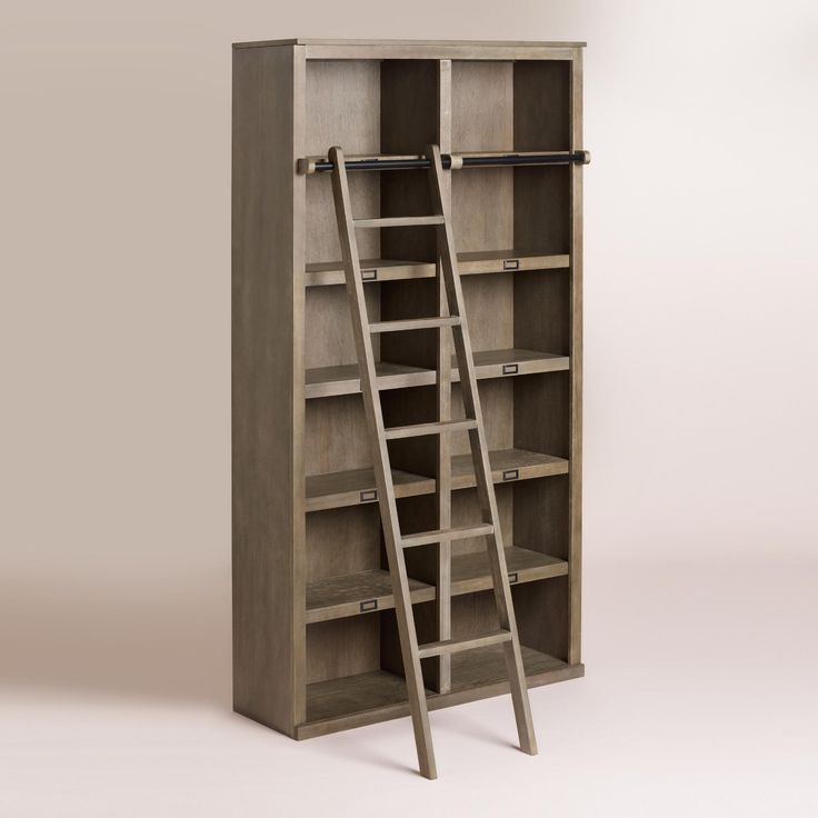 Our substantial bookcase makes an impressive display unit for books and other collectibles. Crafted of weathered gray-finished rubberwood with veneer panels, it houses six shelves and can be fitted with our coordinating ladder.