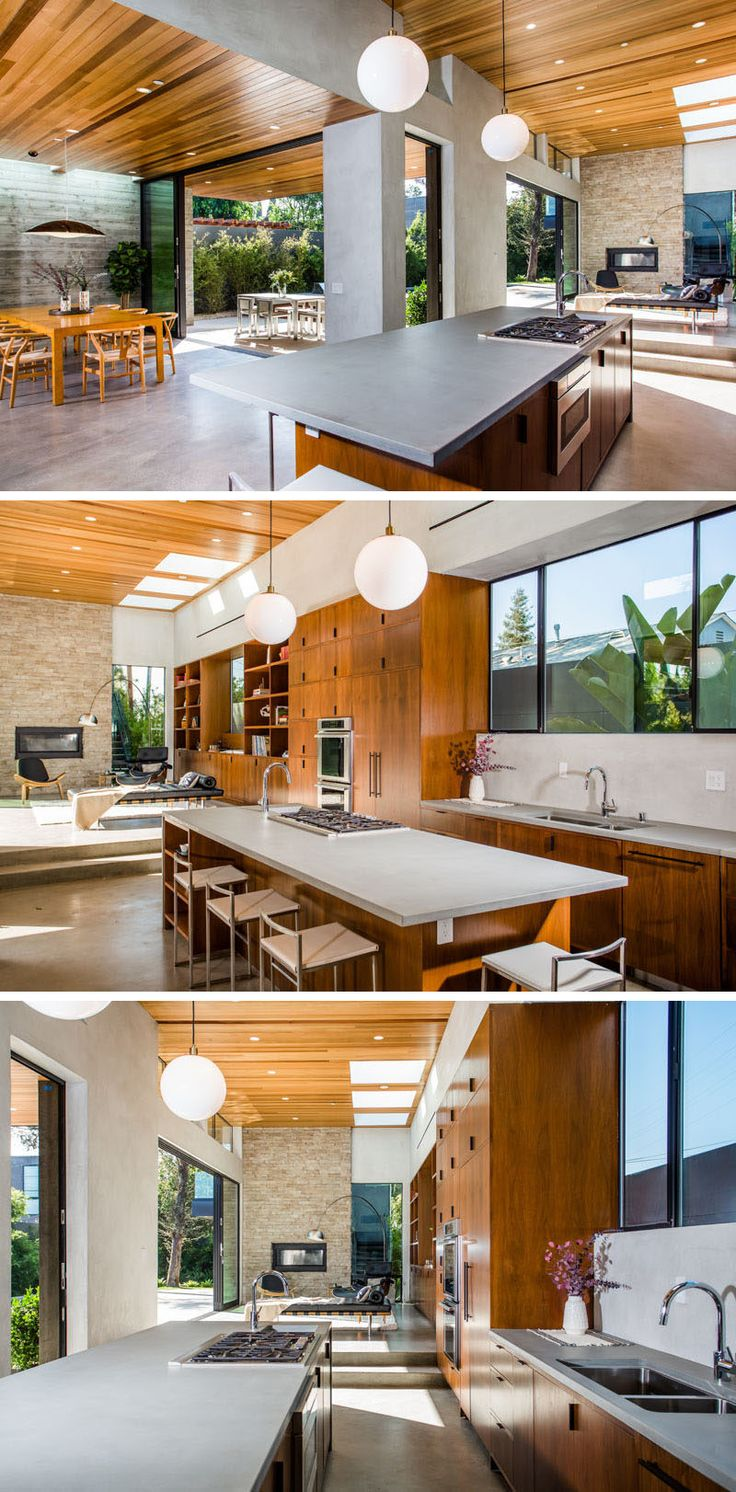 In this kitchen, a light grey counter matches the concrete floor, and wooden kitchen cabinets flow through to the library area.