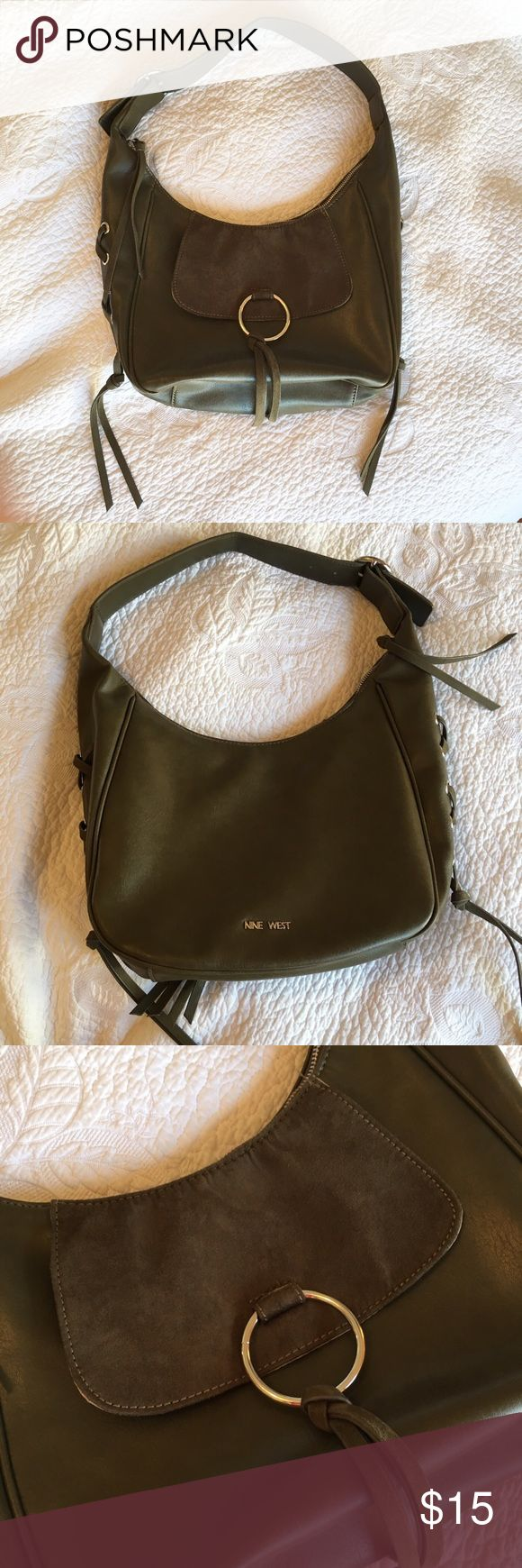 Nine West Olive Green Shoulder Bag The outside is in great condition other than the slight bend in the shoulder strap from hanging on a hook for a while. There are a good number of stains on the inside lining. This is a very stylish bag that has details that remind me of certain Chloe bags. Nine West Bags Shoulder Bags