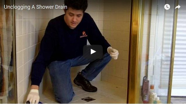 how to clear a clogged drain with standing water