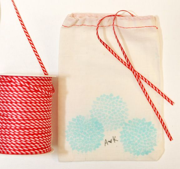 Stamping cloth bags for packaging   from Smitten on Paper