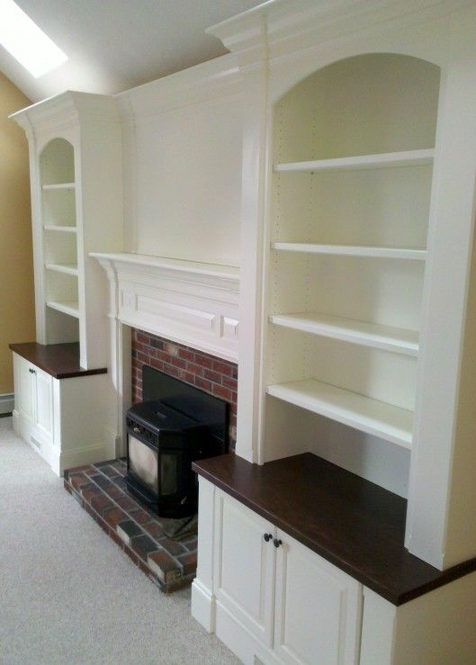 fireplace built in...I have this in my house...love the dark cabinet tops.  I have this a similar set up in my master bedroom--but had a tv cabinet built so you can pull the plasma screen out when viewing!  Love it