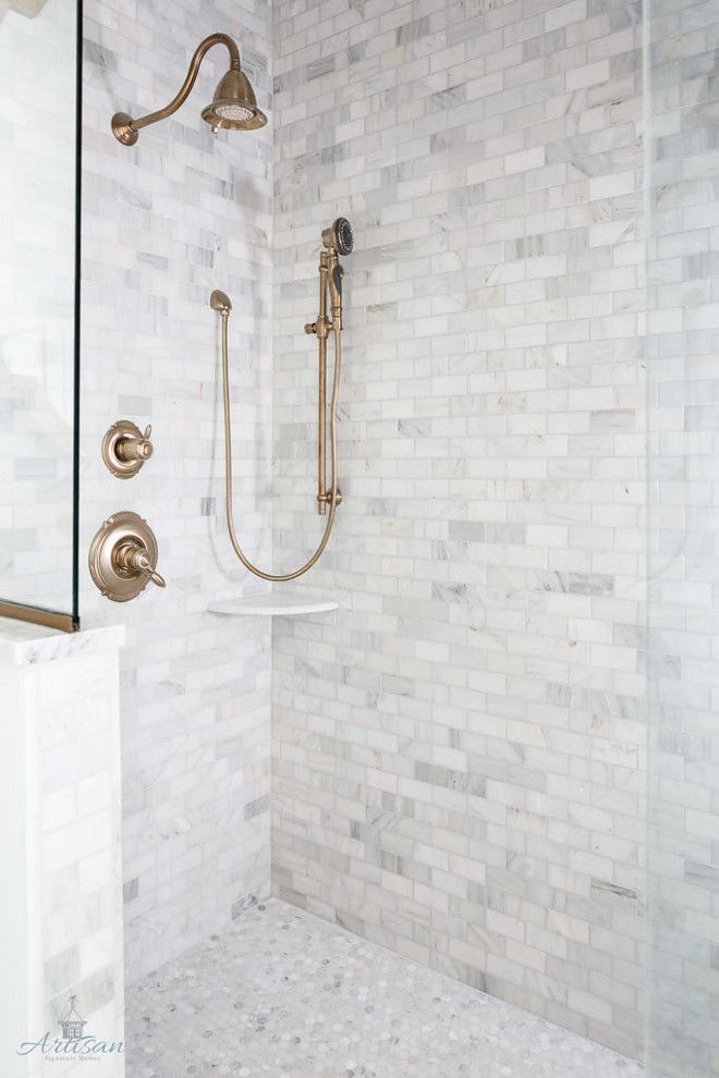 shower tile combination marble subway tile on walls and marble penny tile on the floor