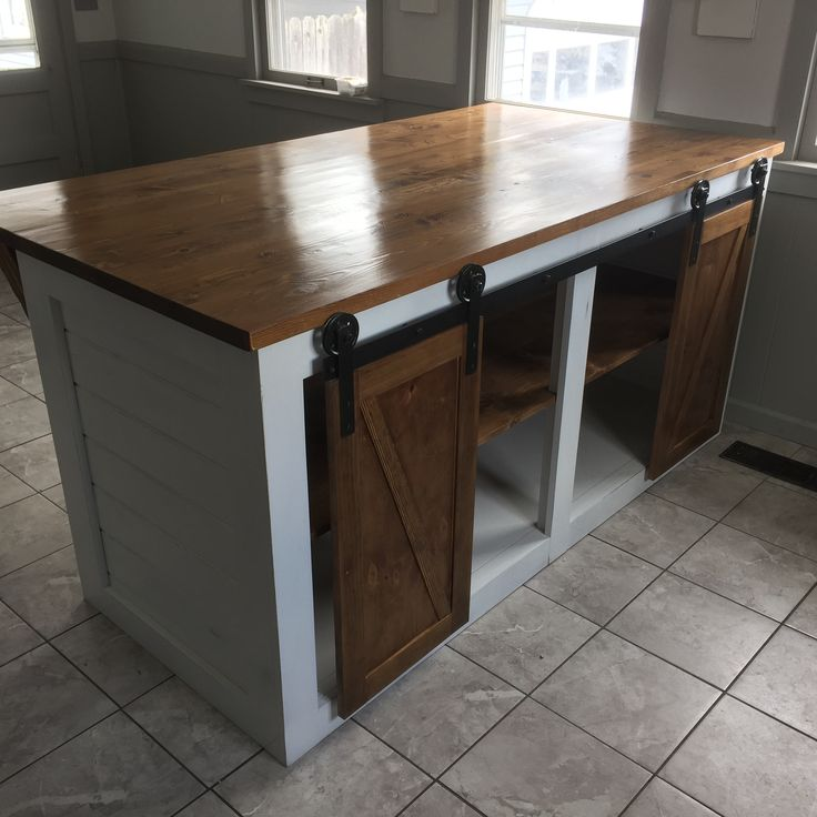 Custom Shiplap Kitchen Island With Sliding Barn Doors And